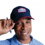 image of smiling AAMCO mechanic, symbol of trust, quality.