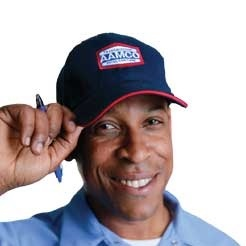image of smiling AAMCO mechanic tipping his hat.