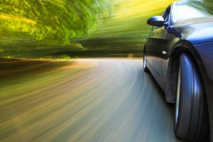 image - car speeding around a bend, with special effects colorized