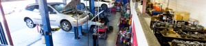 Image of repair shop, cars being fixed.