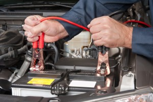 image of jumper cables attached to car battery terminals.