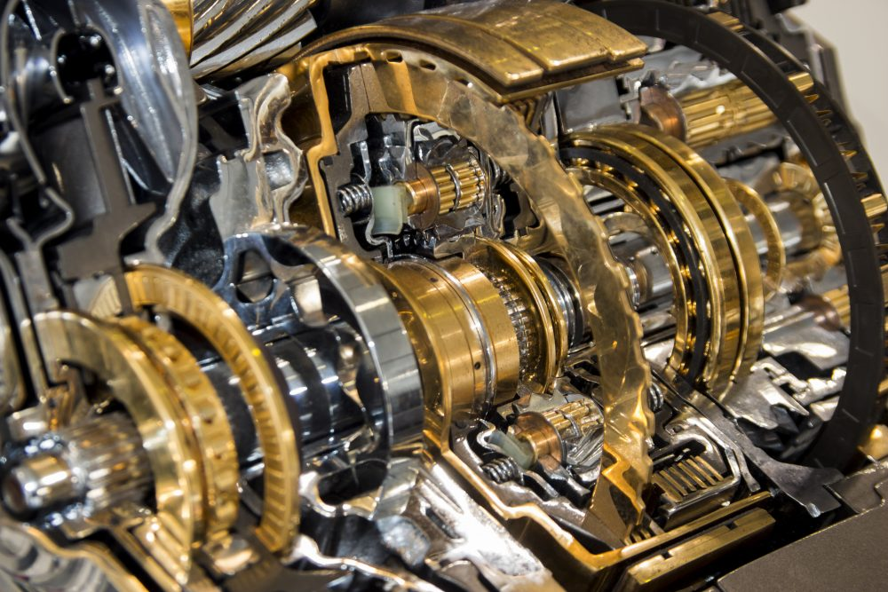 image of automotive transmission gearbox with lots of details, gears, cogs, steel