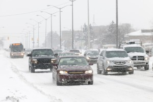 image - traffic in winter - slippery, snow-packed road, cars moving slowly