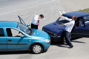 Traffic accident where one driver on the mobile phone, second expressing anger